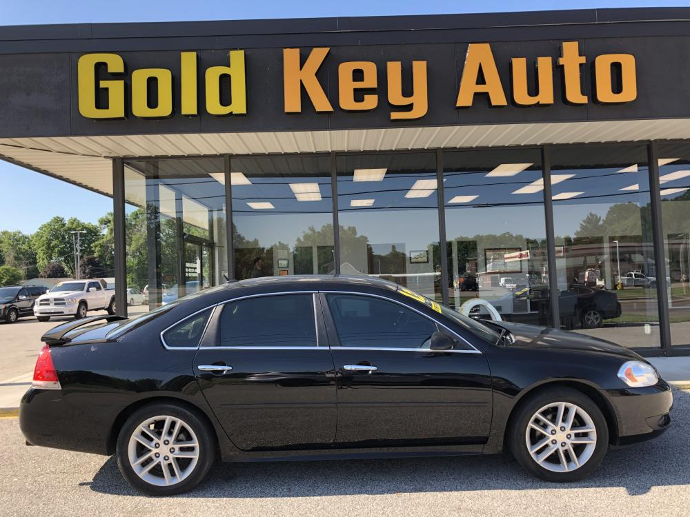 2012 Black Chevrolet Impala LTZ (2G1WC5E33C1) with an 3.6L V6 DOHC 16V FFV engine, 6-Speed Automatic transmission, located at 1633 W Kimberly, Davenport, 52806, (563) 323-5341, 41.559456, -90.598732 - Photo #0