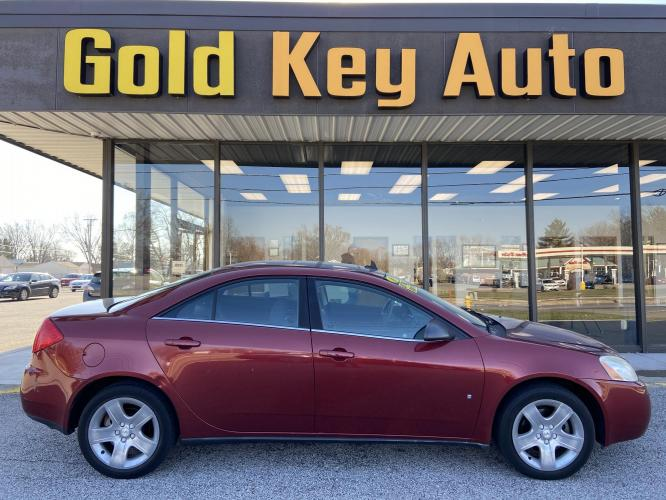 2009 Maroon Pontiac G6 Sedan (1G2ZG57B694) with an 2.4L L4 DOHC 16V engine, 4-Speed Automatic Overdrive transmission, located at 1633 W Kimberly, Davenport, IA, 52806, (563) 323-5341, 41.559456, -90.598732 - Photo #0