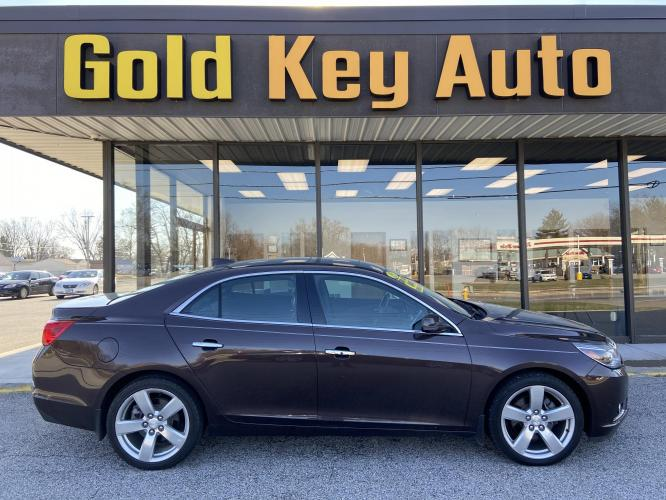 2015 Maroon Chevrolet Malibu 2LTZ (1G11G5SX9FF) with an 2.0L L4 DOHC 16V engine, 6-Speed Automatic transmission, located at 1633 W Kimberly, Davenport, IA, 52806, (563) 323-5341, 41.559456, -90.598732 - Photo #0
