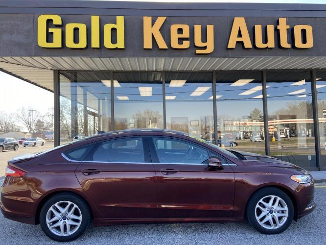 2015 Maroon Ford Fusion SE (3FA6P0H70FR) with an 2.5L L4 DOHC 16V engine, located at 1633 W Kimberly, Davenport, IA, 52806, (563) 323-5341, 41.559456, -90.598732 - Photo #0
