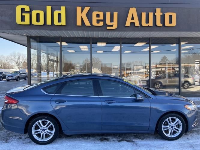 2018 Blue Ford Fusion SE (3FA6P0H73JR) with an 2.5L L4 DOHC 16V engine, 6A transmission, located at 1633 W Kimberly, Davenport, IA, 52806, (563) 323-5341, 41.559456, -90.598732 - Photo #0